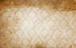 Old dirty paper background with old-fashioned ornament. Royalty Free Stock Images