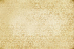 Old dirty paper background with vintage patterns. Royalty Free Stock Images