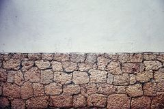 Old dirty partly clay brick wall, background or wallpaper. Royalty Free Stock Image