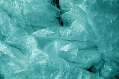 Old dirty plastic texture in cyan tone. Abstract background and texture for design stock images