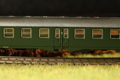Railroad model scene. An old and dirty plastic train toy model represent the train toy for hobby and collection concept related idea royalty free stock photo