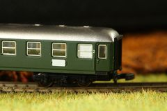 Railroad model scene. An old and dirty plastic train toy model represent the train toy for hobby and collection concept related idea stock images