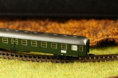 Railroad model scene. An old and dirty plastic train toy model represent the train toy for hobby and collection concept related idea royalty free stock image