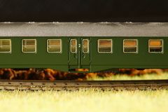 Railroad model scene. An old and dirty plastic train toy model represent the train toy for hobby and collection concept related idea royalty free stock photos