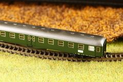 Railroad model scene. An old and dirty plastic train toy model represent the train toy for hobby and collection concept related idea stock photography