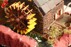 Old watermill model scene. An old and dirty plastic watermill model scenery represent the model toy and hobby concept related idea royalty free stock photos