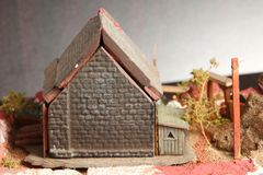 Old watermill model scene. An old and dirty plastic watermill model scenery represent the model toy and hobby concept related idea stock photo