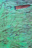 The old dirty plywood. On green paint background Stock Photo