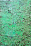 The old dirty plywood. On green paint background Royalty Free Stock Image