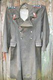 Old dirty police overcoat Stock Photos