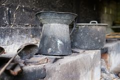 Old dirty pots in asian street kitchen. Or cafe Stock Photo