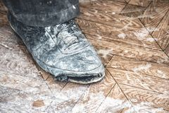 Old dirty ripped shoes stock photography