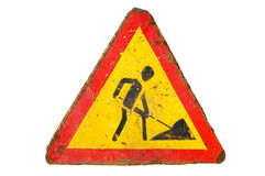Old dirty rusty triangular road sign `Under construction`. Stock Images