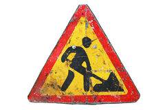 Old dirty rusty triangular road sign `Under construction`. Stock Photos