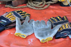 Old or dirty safety gloves on the works Stock Image