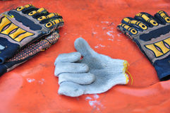 Old or dirty safety gloves on the works Stock Photos