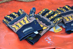 Old or dirty safety gloves on the works Stock Photo