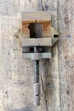 Old, dirty press against wooden plank. Tool series stock images