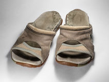 Old dirty shoes. Favorite female sandals. royalty free stock image