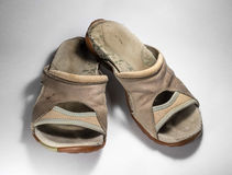 Old dirty shoes. Favorite female sandals. stock photo