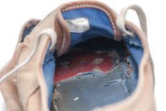 Old & dirty shoes on white Stock Photography