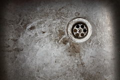 Old dirty sink with rusty metal drain closeup Stock Images