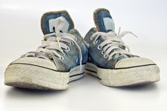 Old, dirty sneakers over white background Stock Photos