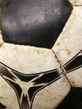Old dirty soccer ball detail close-up. Macro Royalty Free Stock Photo
