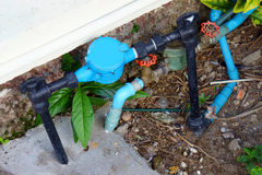 Old and dirty tab water pipe and meter on ground Royalty Free Stock Photography