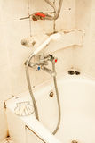 Old dirty tap on the bath Stock Images