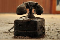 Old dirty telephone. In the attic Stock Images