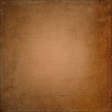 Old dirty textile background with seams. Old, dirty and stained textile background with seams around Stock Photos