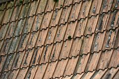 Old dirty tiled roof with moss Stock Image