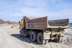 Old dirty tipper. Road under construction Royalty Free Stock Photos