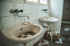 Old dirty toilet in abandoned psychiatric hospital building. dirt and disorder on social facilities stock photos