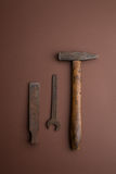 Old dirty tools. Set of old dirty tools on brown background stock photography