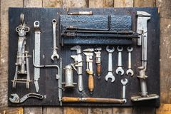 Old dirty tools set, car mechanics wrenches. Jack stand royalty free stock image