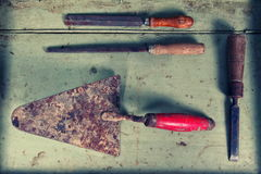 Old dirty tools on table Royalty Free Stock Image