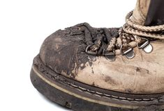 Old dirty trekking boot. Close-up view. Royalty Free Stock Photo