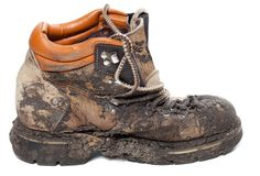 Old dirty trekking boot. Side view. Royalty Free Stock Photos