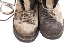 Old dirty trekking boots on white background Royalty Free Stock Image