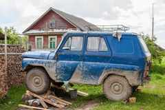 Old, dirty UAZ car repaired in a village Stock Image