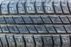 Old and Dirty Used Car Tires Texture. Close Up stacks of old Tires. royalty free stock image