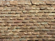 Old dirty vintage roof stone brick wall grunge surface rough material background Stock Image