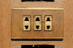 Old dirty wall plug in a derelict building Royalty Free Stock Photo