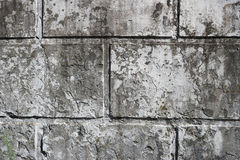 Old dirty wall with rectangular slabs and remains of a whitewash layer Royalty Free Stock Photos
