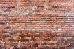 Old, dirty wall of red brick. stock image