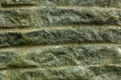 Old dirty weathered wall covered with small cracks stock image