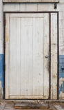 Old dirty white door Royalty Free Stock Images
