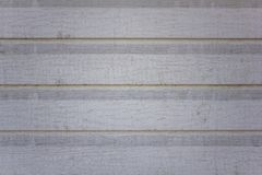 Old dirty white gray beige wall fence from wooden boards. horizontal lines. rough surface texture. A old dirty white gray beige wall fence from wooden boards stock photos